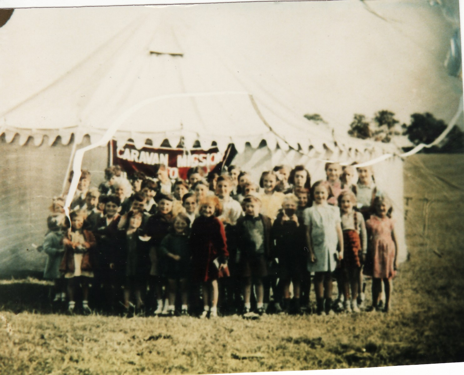 Early 1950s. Caravan Mission held in a field behind 28/30 South Street and Lister Cottage.