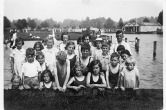 c. 1930 Sunday School Outing, at Wicksteed Park.Front row: Poppy Broom, Eileen Carpenter, Heather Portlock, Dora Gibson, Roy Eaglestone, Sylvia Portlock.Middle row: John Stevens (in shirt) Nigel Wood, Roy(?) Portlock, June Shirley, Cyril Shirley, Horace Wood (in shirt), Rita Stewart and Kathie Bolton (in black cap).
