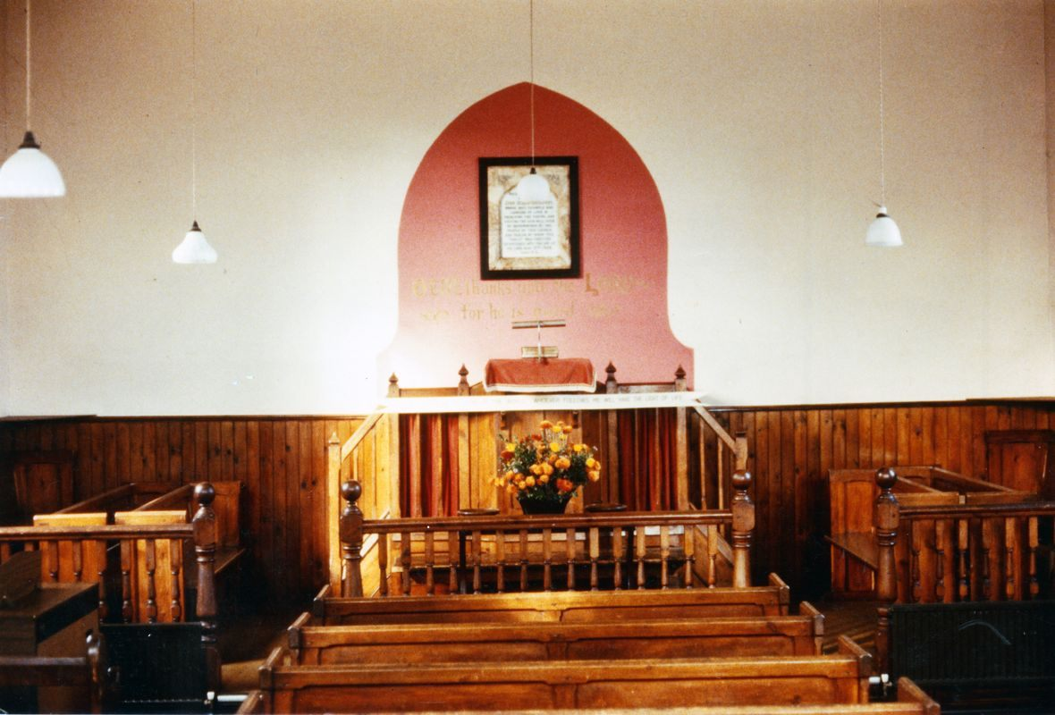 Pre 1984. The main entrance led into a small lobby with doors either side into the chapel. Between the doors, facing into the chapel, was a cupboard. There was a text on the wall above the pulpit: 'O GIVE THANKS UNTO THE LORD FOR HE IS GOOD'.