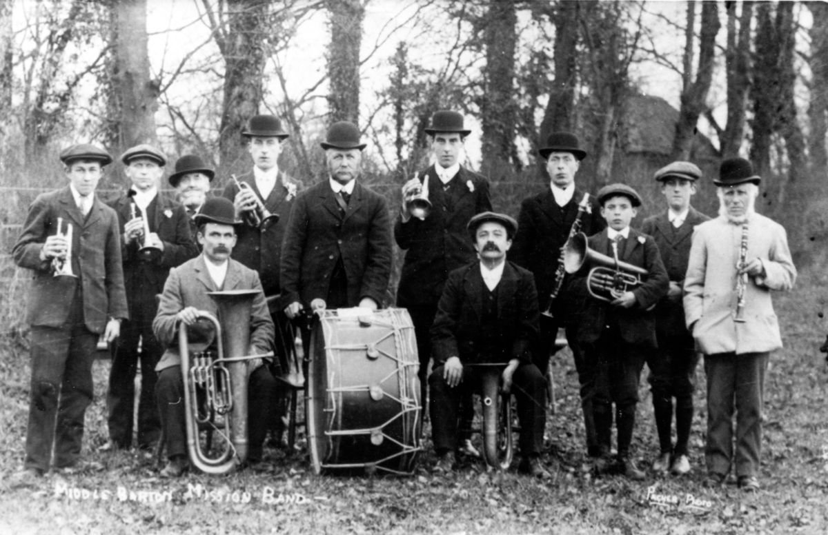 1910 Middle Barton Mission Band. Back: Fred Reeves, Will Stewart, Solomon Stewart (from Canada), Jim Castle, Alfred Reeves (with drum), Ken Castle, Charlie Hawtin, Bert Stewart, Horace Castle, Teddy Matthews. Seated: Archie Reeves, George Kirby.