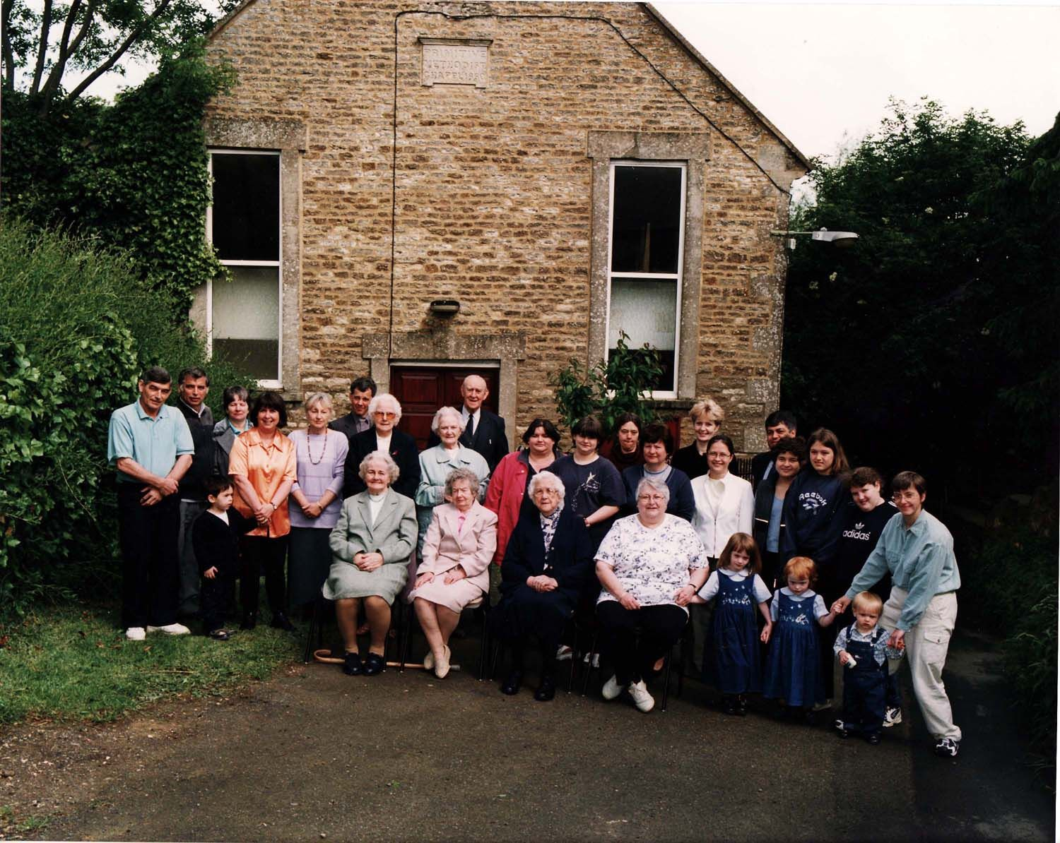 2000 Millennium photograph, (left to right, front row) Mrs Hilary Bassett, Mrs Ethel Evans, Mrs Brown, Deanna Gardner, Emily, Rosie and James Caldwell, Louise Caldwell.