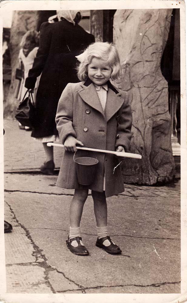 ~1948 Deanna Gardner nee Stewart with bucket and spade. Possibly Bognor Regis.