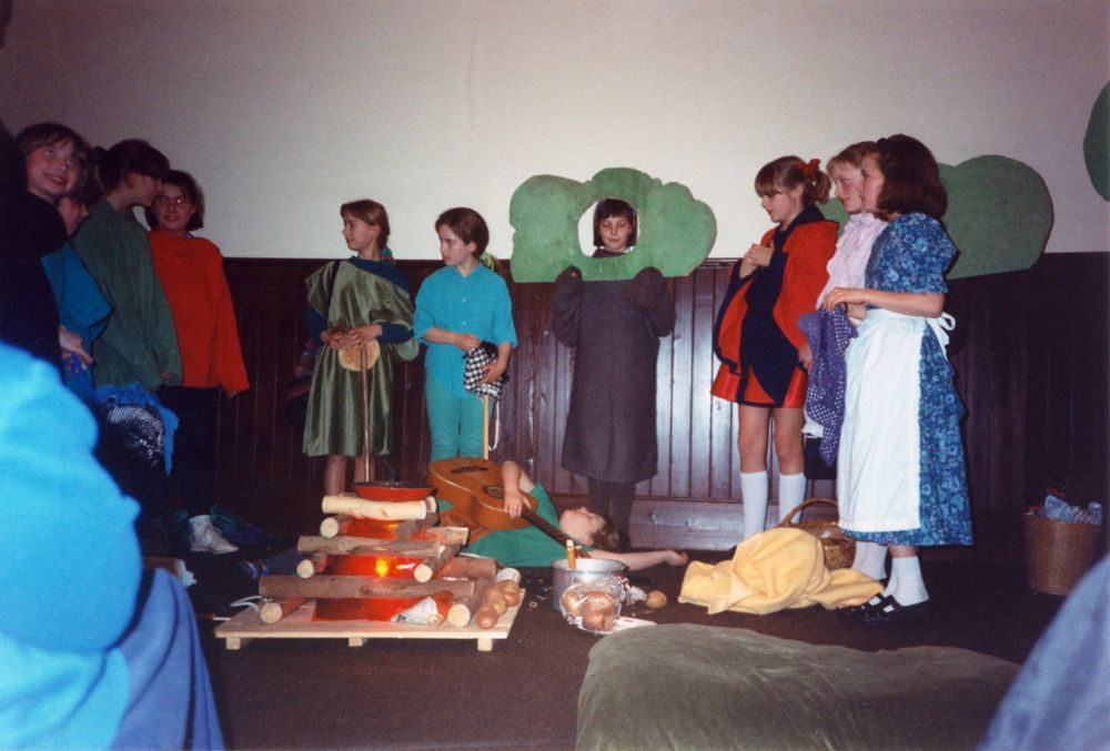 12 March 1992 Guides Pantomine. L to R: Alexis Thomson, Nicky Burwell, Hester Gathony, Lucy Waring, Louise Phipps, Hannah Schneider, Sarah Parrett (brown dress) Tricia Houston, Eleanor Norgrove, Emma Jones.