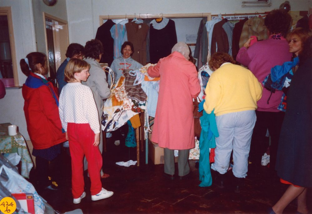 November 1989 Dorn Valley Venture Unit Jumble Sale. Eleanor Norgrove (back view), Christine Edbury (at back), Muriel Cox (back view) and Rita French (extreme right).