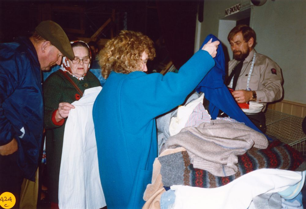 November 1989 Dorn Valley Venture Unit Jumble Sale. Mr. and Mrs. Denton (left) and Bill Edbury (right) VS Leader.