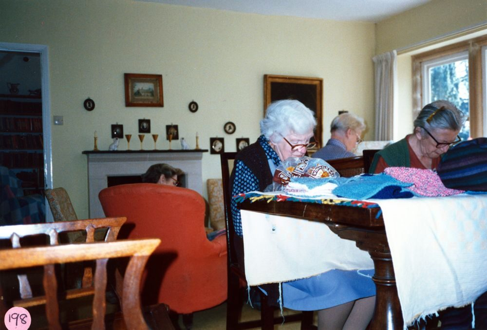 23 April 1987 Sewing squares for Oxfam blankets. L to R: Kathleen Murray (in armchair), Ruth Kirby, Charis Stevens and Winnie Gibbons.