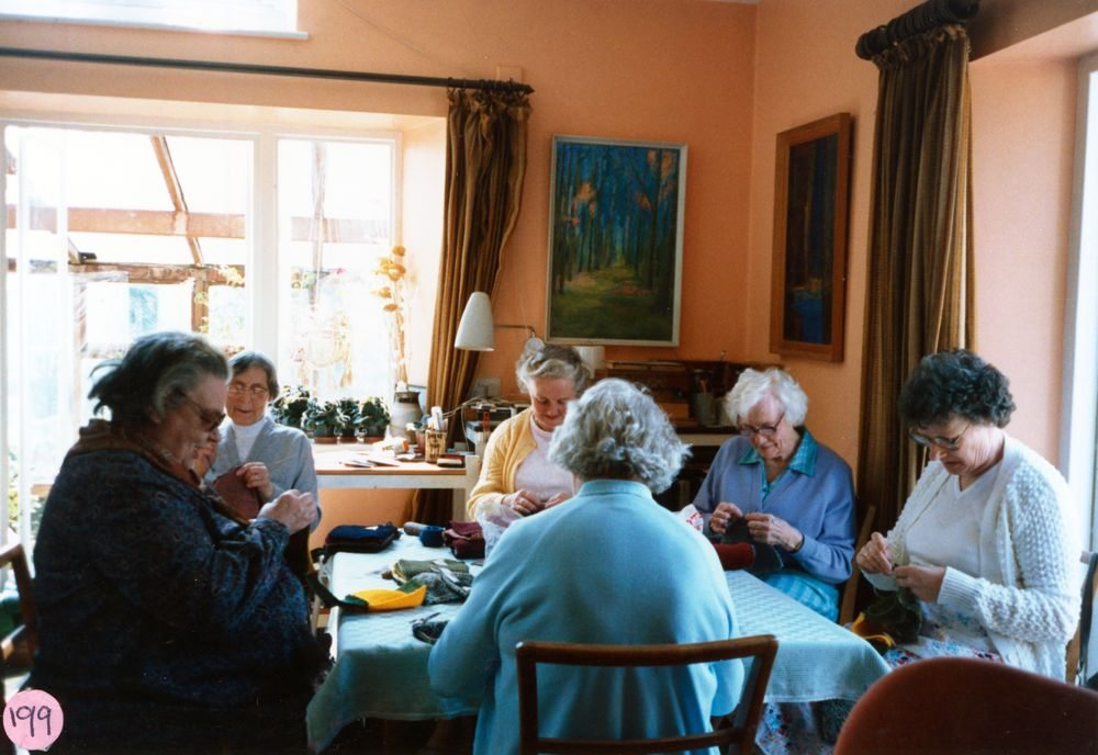 23 April 1987 Sewing squares for Oxfam blankets. Foreground: Beryl Wyatt (back view). Round the table L to R: Bubbles Pratley, Dorothy Smith, Hilary Bassett, Margaret Hazell and Marion Pettengell.