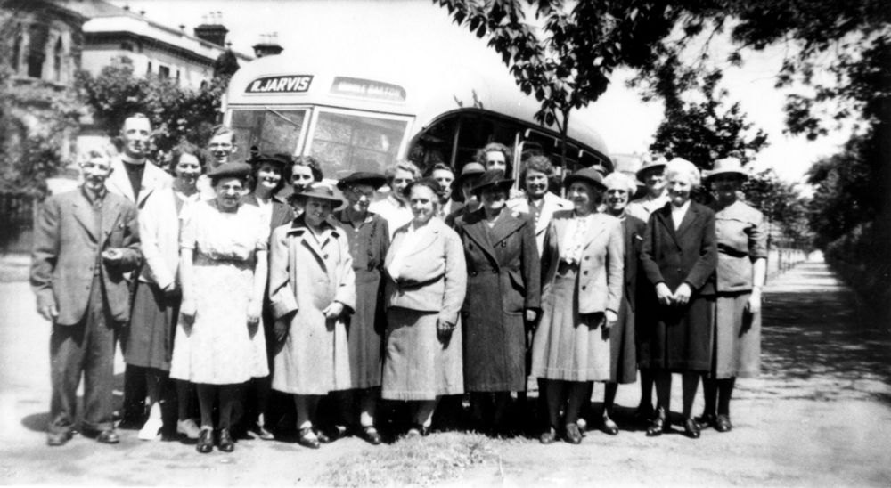 Late 1940s Mothers Union Outing. Front row: ?, ?, Winnie Gibbons, Eliza Stewart, Nurse Parrish. Middle row: Reverend A. N. Blanchett, Winifred Pritchard. Back: Ruby Pratley.