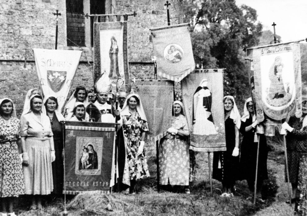 1960s Dedication of the new banner at Steeple Barton Church. Back row l to r: ?, Mary West, Margaret Allen, Reverend J. Wilmot Griffiths. Front row l to r: Nellie Cattle, Mary Osment, Elsie Cox, ?, Bishop, Winnifred Pritchard, Ada Stockford.