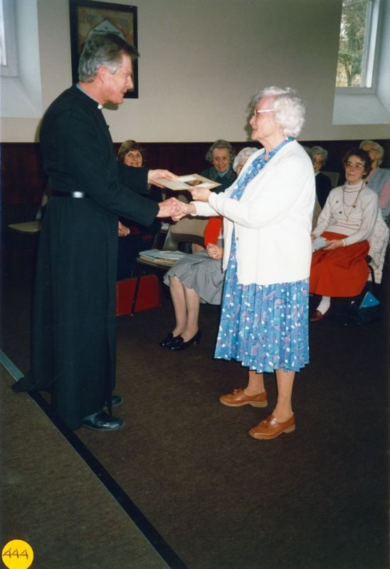 6 March 1990 Presentation to Margaret Hazell. L to R: Reverend Tony Davies, Jeanne Allington, Elsie Bridger, Ivy Reader, Margaret Hazell and Joan Jeffries (seated right).