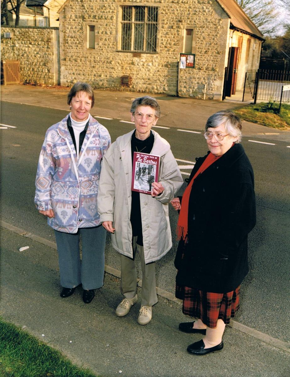 c. 1999. Bartons' History Group. Chris Edbury, Audrey Martin and Kay Davies in front of the Alice Marshall Hall.