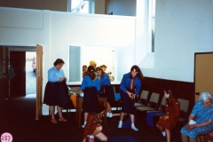 July 1987 Guides and Brownies Open Meeting. Peggy Gregory by the door.