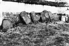 1966 Steeple Barton Church. Head stones (five of them Eaglestone memorials) put against the church's north wall when tombstones were removed in 1966.