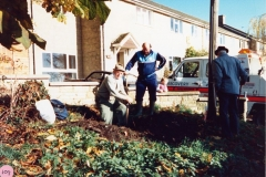November 1986 Roy Eaglestone, John Woodley and Ken Castle (back view) uncovering the milestone buried by Roy's father in the Second World War.