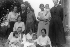 c. 1922 House on the bank. May Squires and her husband. Left: Miriam Dallinger. The baby is her daughter, Jean. Betty Dallinger is in the centre of the front row.