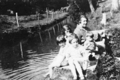 1920s Children by the mill stream - Left to right: Jean and Betty Dallinger, Joan and Roy Eaglestone. Miriam Dallinger in the background.