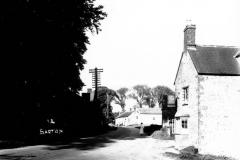 c.1920. Enstone Road looking east. On the north side, the Castle family workshop. On the south side, the Fox pub and numbers 11 - 15.