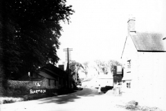 c.1920. Enstone Road looking east. On the north side, the Castle family workshop. On the south side, the Fox pub and numbers 11 - 15. Replicate.
