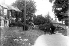 1920s Enstone Road looking east to the crossroads. North side: workshop of the Baker family, then cottages 6 to 2.