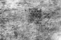 6 Mill Lane, bricked up window at Florence Farley's shop.