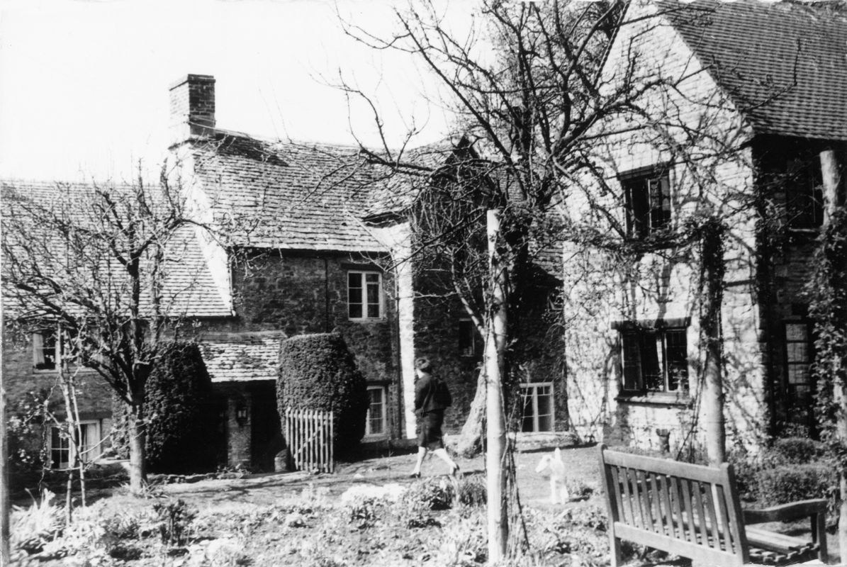 Rear view of the Old Malt House, Fox cottage on the right. Miss Sullivan and her dog.