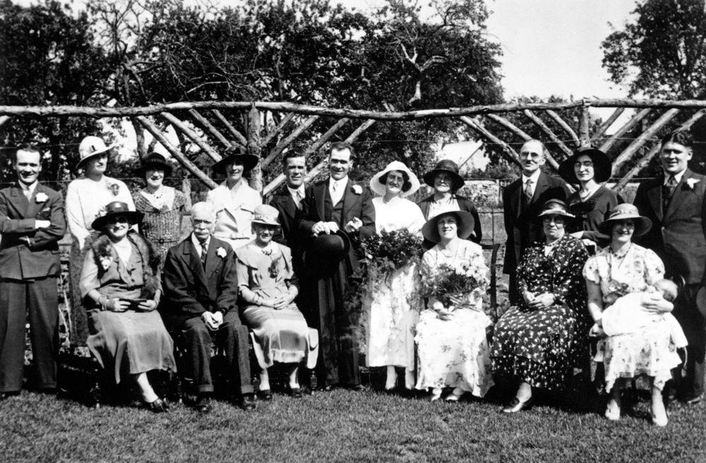 11 August 1934 Wedding of James Humphries and Winifred Kirby. Back: Frank Humphries, Agatha Ayres, Mrs Ruth Kirby, Mary Goffe, Bob Humphries, Jim and Winnie, Annie Stockford, Edward Cox, Joan Cox and Thomas John 'Taff' Owen.