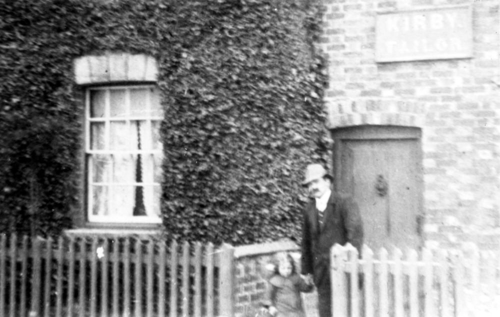 c. 1916 George Henry Kirby with his daughter Ruth Elizabeth Annie at the front of 67 North Street. He took over the tailoring business from his father.