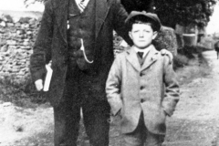 c. 1925 George Kirby and his son, George, on their way to chapel.