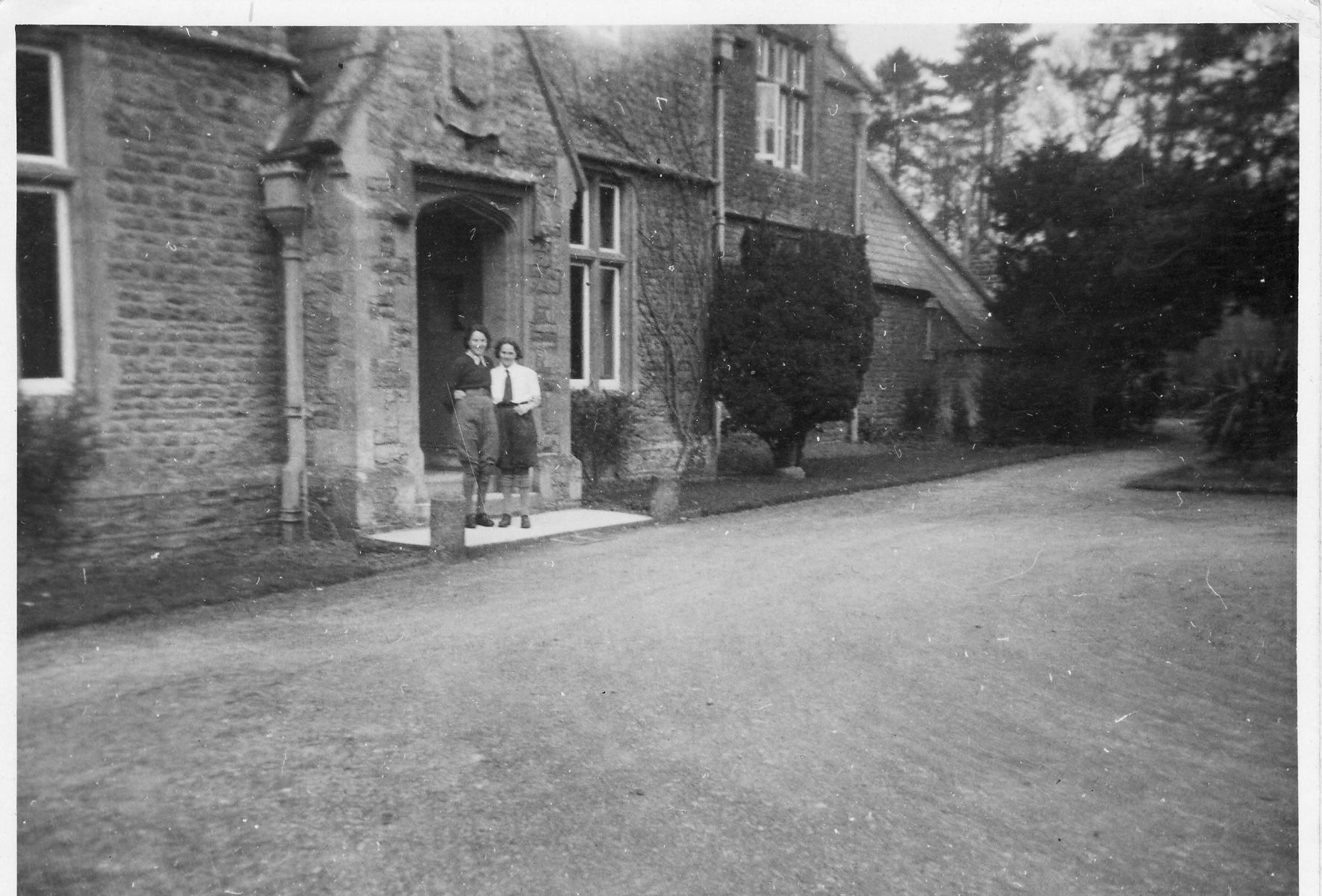 1942. Entrance to Westcote Barton Manor (Hostel). Olive and I.