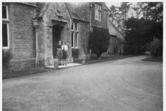 1942. Entrance to Westcote Barton Manor (Hostel). Olive and I.