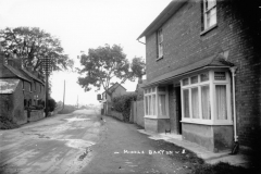 c. 1926 Left side: 21/23 North Street, Post Office 1895-1932 and a builder's workshop. Right side: 20 North Street and the Three Horseshoes.