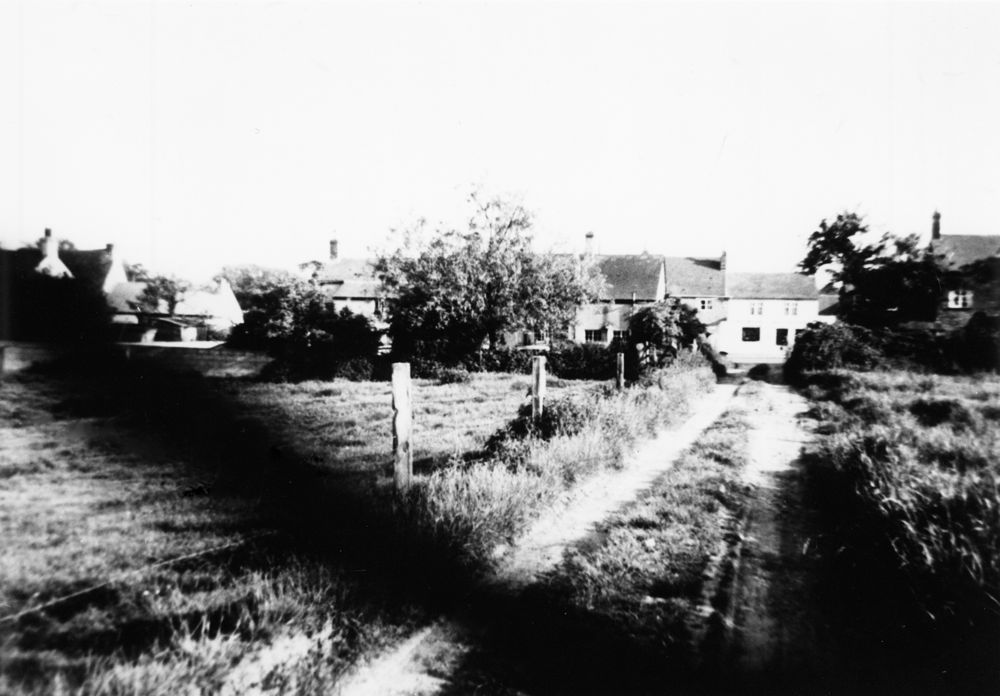 1970s. Track and fields on the north side of the road, now part of the Firs estate - looking south. There is still a short length of track near the road between No. 67 and No. 69.