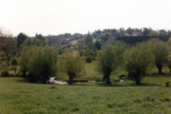 View of the Dorn stream and houses beyond on South Street, Mill Lane and Church Lane from North Street.