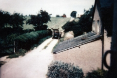 1970s. Track and fields on the north side of the road, now part of the Firs estate - looking north.