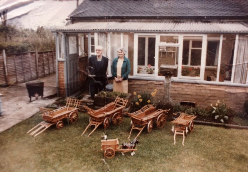c. 1980 16 Enstone Road. Ken and Cicely Castle with model wagons made by Ken Castle.