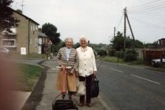 1988 Mrs. Winifred Pritchard and Mrs. Lilian Davis in Enstone Road on their way to Westcote Barton churchyard.
