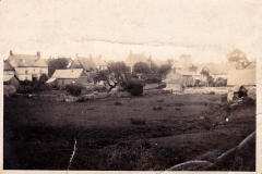 Looking north-east from Holliers field. At top left, the front of Farley's house and shop. The building on the right is a now-demolished part of the old mill. Also demolished cottages in Jacob's Yard.