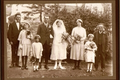 Marriage of Hilda Adams and Sid Cox. From left: Walter Cox (Sid's brother), Lily Adams (Hilda's niece), unknown bridesmaid, Sid, Hilda, Dorothy Cox (Sid's sister), unknown bridesmaid, Mr. Adams (bride's father).