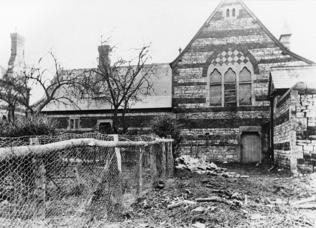 The fenced area on the left was the teacher's garden.