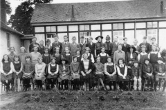 1932. Steeple Aston Central School. Middle row: 5th from right Mabel Woods (Rousham), Violet Adams (Rousham), ?,?, Violet Wyatt (Middle Barton). Front Row:  4th from left Sylvia Keen (Middle Barton), two of the Brownies on the right are Cross sisters (Steeple Aston).