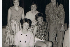 1962. Gillian Savage, from Middle Barton, (on the right), Steeple Aston School Fashion Show. Other girls unknown.