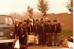 c. 1980 Bartons' Scout Group. Adults: left Lewis Yates (helper), right John Keefe (leader). Back row l to r: Kevin Benn, ?, Stephan Cox, Paul Spry, Tim Yates, Martin Benn. Front row l to r: Matthew Hansen, ?, ?, Guy ?  (School 2)