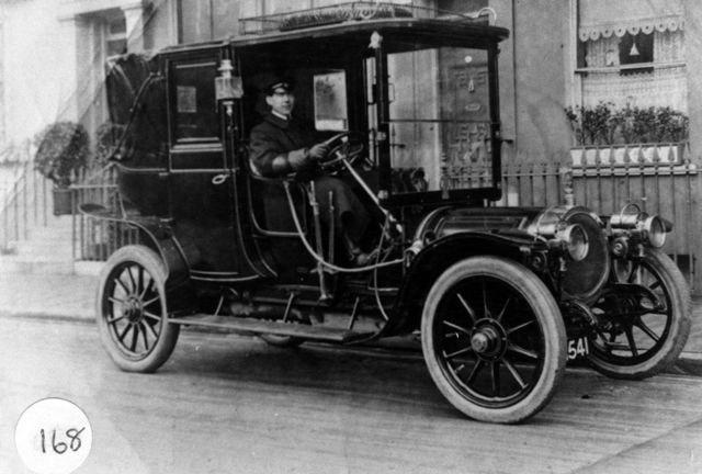 W. G. Checkley driving a taxi in London.