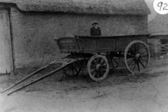 c. 1910. Bill Irons in his father's wagon outside Hollier's Farm Barn.