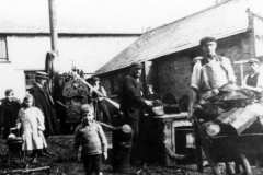 Early 1900s. Moses Castle, Jim Castle, William Brain and others at work on Westcote Barton Rectory. The Rev. R.S. Edwards (wearing boater) was the Rector.