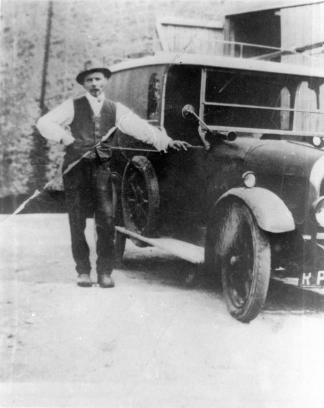 Charles Boffin and his car against the barn of ?