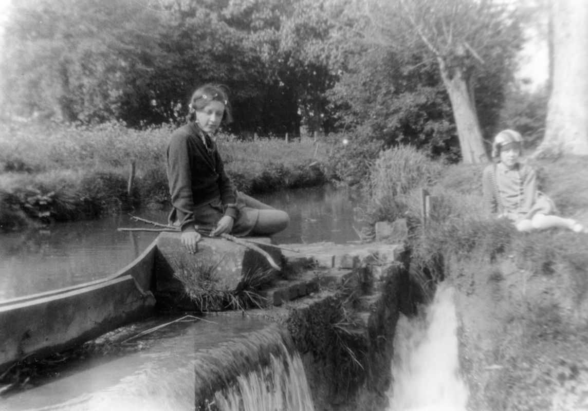 1925 Betty and Jean Dallinger at the waterfall where the lasher divided the water for the mill from the brook.