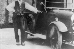 1920s Charles Boffin by his car outside the garage of 35 South Street.