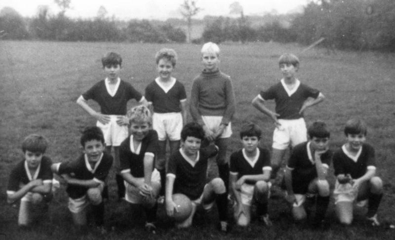 c. 1969 Middle Barton School Team. Back: Neil Shirley, Trevor Stewart, Stephen Monk, Edmund Sokol. Front: ?, Tim Fowler, Melvin Wetherall, John Fowler, ?, ?, Keith Morley, John Bunce. Colours were maroon and white (info from Ed Sokol).