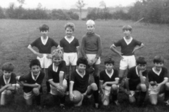 c. 1969 Middle Barton School Team. Back: Neil Shirley, Trevor Stewart, Stephen Monk, Edmund Sokol. Front: ?, Tim Fowler, Melvin Wetherall, John Fowler, ?, ?, Keith Morley, John Bunce. Colours were maroon and white (info from Ed Sokol).